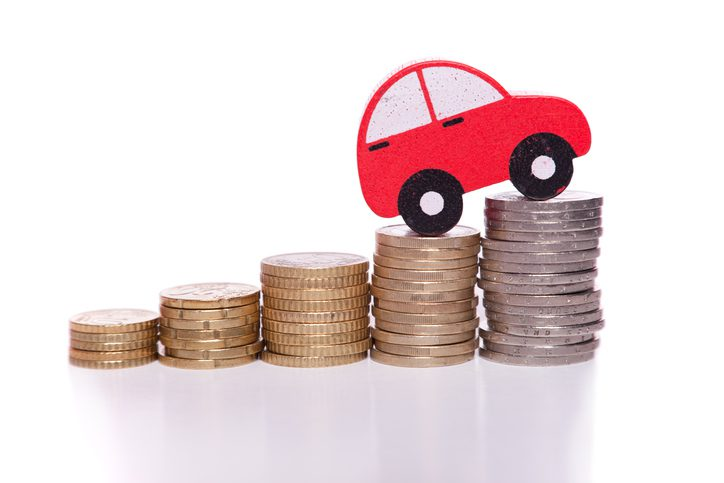 Gill Insurance   Red car cutout climbing stacks of coins